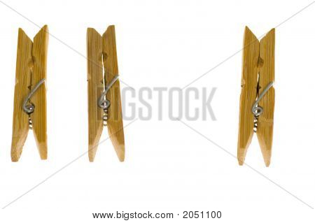 Three Wooden Clothes-Pegs