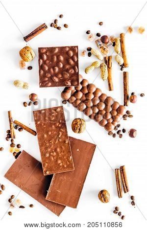 Chocolate bars on white background top view.