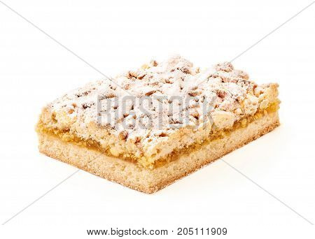 Lemon pie topped with sugar powder on white background. Macro photography with great depth of field. DoF .