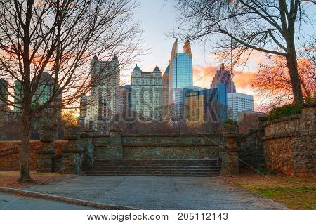 View of stone stairs in the Piedmont Park and Midtown Atlanta behind it in autumn evening USA