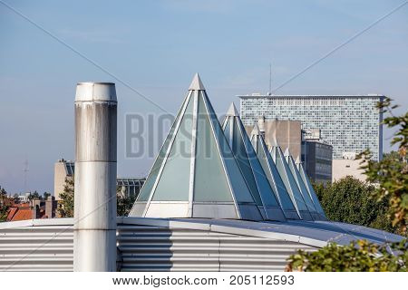 Plastic Dome in a row on a metal roof