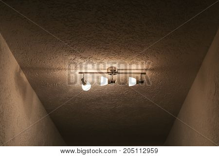 Luster on the ceiling with three bulbs