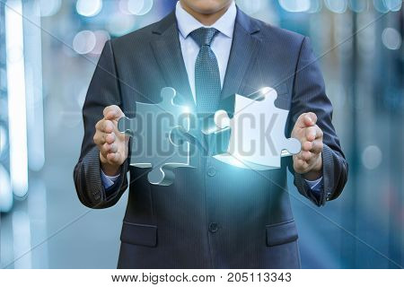 Businessman Connects The Puzzles .