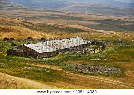 An Abandoned House In The Steppe, A Barn For Animals. The Ukok Plateau In The Altai. Fabulous Cold L