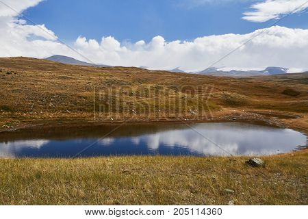 A Small Lake In The Steppe, Fall Among The Mountains. The Ukok Plateau In The Altai. Fabulous Cold L