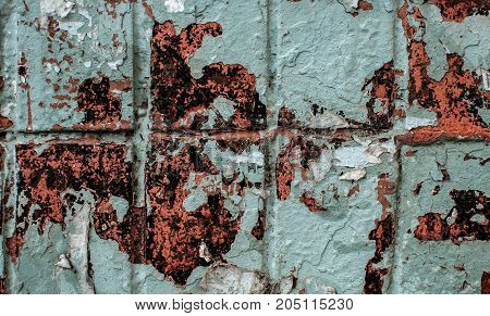 Blue Wall Tiles Texture Background With Old Peeling Paint, Spots And Scraps Of Ads