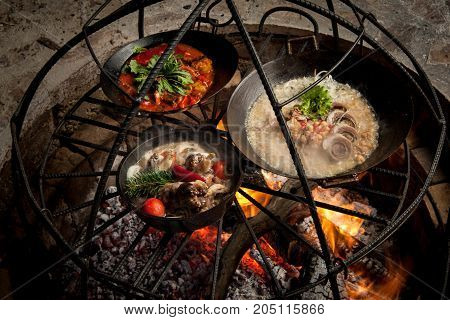 the preparation of meat dishes in a frying pan on the fire