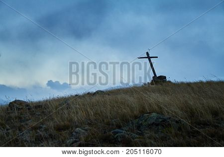 Lone Grave In The Steppe, The Old Wooden Cross On The Grave. The Ukok Plateau Of Altai. Fabulous Col
