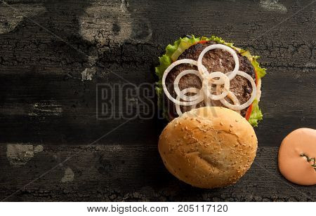 Cheeseburger On A Wooden Surface