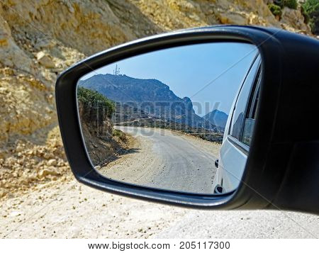 Landscape of the island of Kos (Greece) seen in the rear view mirror of a car
