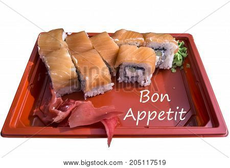 Rolls with salmon and pickled ginger on a red tray isolated on white background with an inscription Bon appetit.