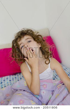 awakening girl yawning bed messy morning hair white room