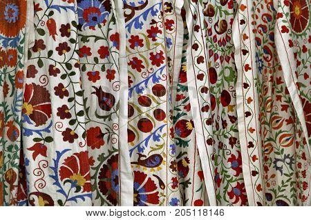Traditional uzbek suzani embroidery fabrics at oriental bazaar, Bukhara, Uzbekistan