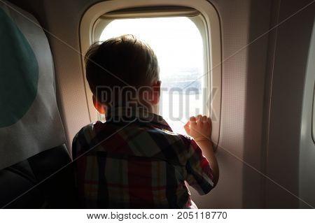 Child Looking Through Porthole