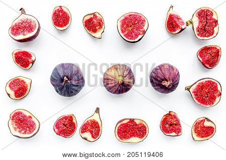 Fresh blue figs slices pattern on white background top view.