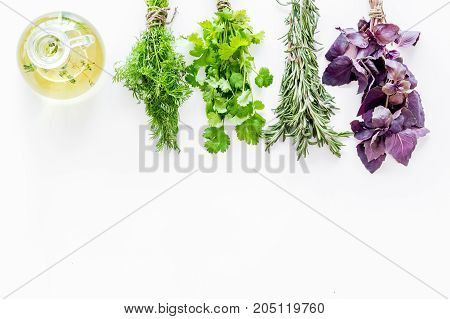 greenery with natural oil for home food cooking on white kitchen table background top view mock-up