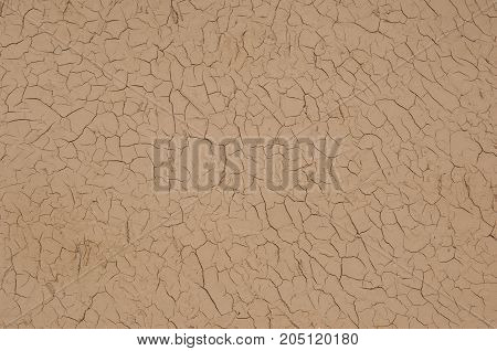 the background of brown color dried and cracked clay