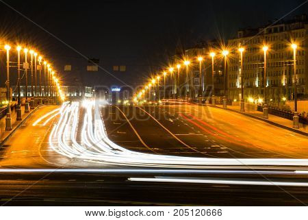 Busy street in the city at night, full of car light streaks dynamic night shot with long exposure motion blur effect