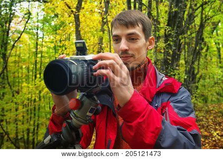 autumn forest photographer. professional photographer at work