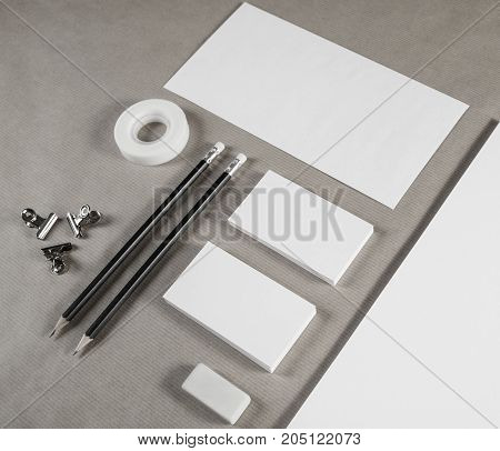 Blank stationery set on craft paper background. ID template. Mockup for branding identity for designers.