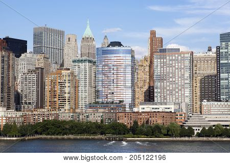 The view of South Cove Park by Hudson River and Lower Manhattan Skyscrapers (New York City).