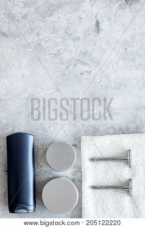Men's shaving. Tools and cosmetics on grey stone background top view.