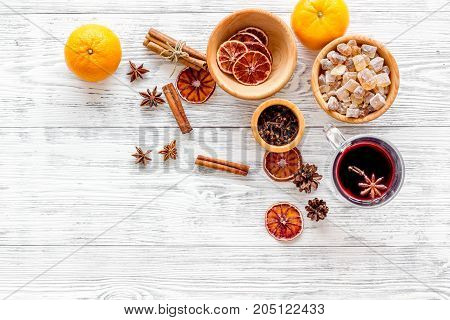 Merry christmas in winter evening with warm drink. Hot mulled wine or grog with fruits and spices on light desk background top view mock-up