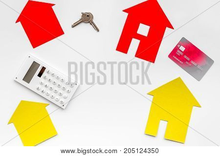 purchasing house set with online credit card payment on work desk white background top view mock up
