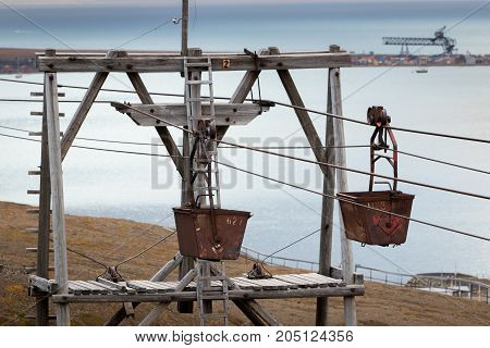Detail of two carts of old and historic cableway (Taubane) for transporting coal from coal mines to harbour in Longyearbyen Svalbard.