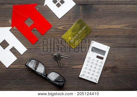 purchasing house set with online card payment on work desk wooden background top view