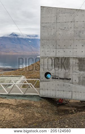 Svalbard August 2017: Entrance to the Global Seed Vault at Spitsbergen island in Svalbard archipelago. The world's largest seed storage opened by the Norwegian Government in 2008. Crates of essential food crops seeds are sent from all across the globe