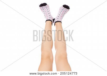Female feet in socks warm on a white background isolation