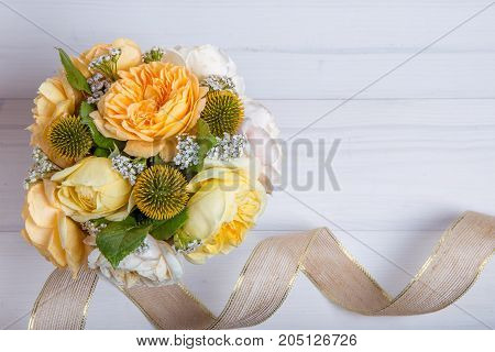 Beautiful English rose flower bouquet on wooden background. Copy space. Mother's, Valentines, Women's, Wedding Day concept.