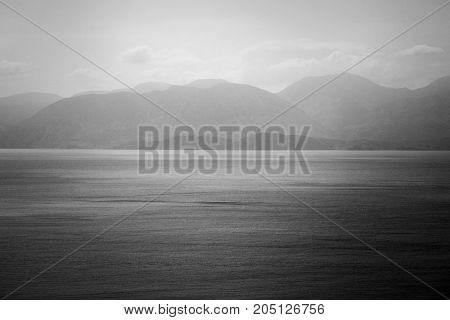 sea, mountains landscape, sailboat sailing far from seashore