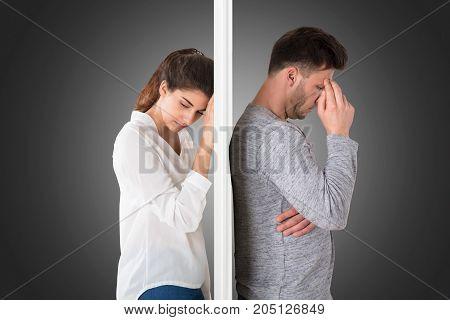 Photo Of Sad Depressed Couple On Gray Background
