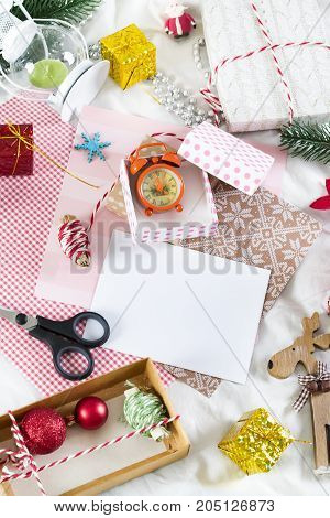 Christmas card. Gift boxes and kraft paper on white background.New Year