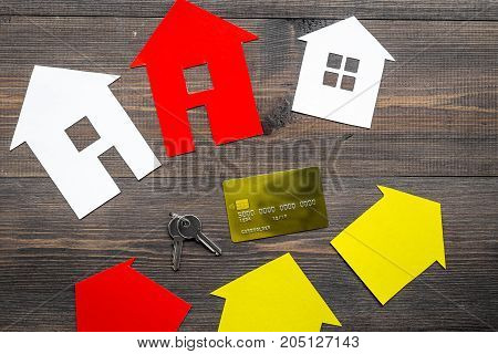 work desk with paper house figures for selling house set wooden background top view