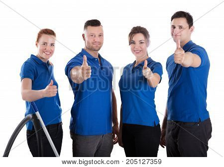Portrait Of Happy Janitors Showing Thumb Up Sign Against White Background