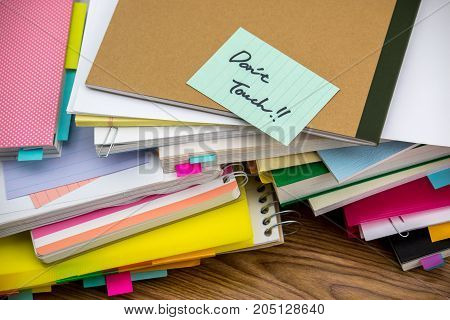 Do Not Touch; The Pile Of Business Documents On The Desk
