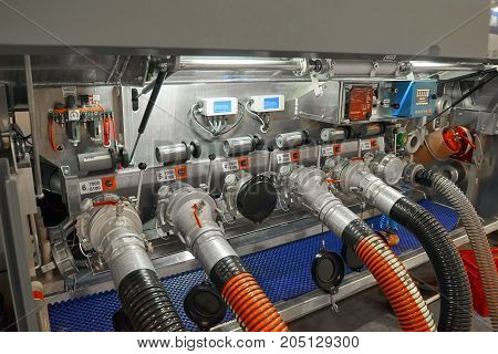 View on truck trailer fuel tank equipment and connected fuelling hoses. Fuelling trailer control board. Fuel tank pump control equipment fuelling process imitation truck trailer equipment compartment