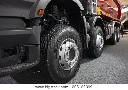MOSCOW, SEP, 5, 2017: View on Volvo truck wheels and tires. Truck wheel rim. Truck chassis exhibit on Commercial Transport Exhibition ComTrans-2017. Commercial transport car truck wheels tires