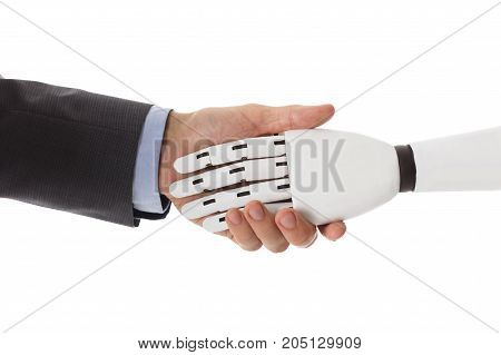 Close-up Of Businessperson Shaking Hands With Robot
