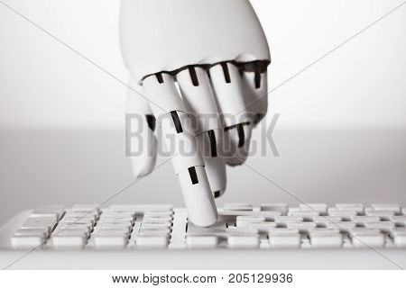 Close-up Of Robotic Hand Pressing Enter Key On Keyboard