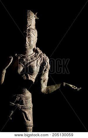Hinduism religious diety. Traditional Hindu Goddess Lakshmi bronze statue. Black background with copy space.