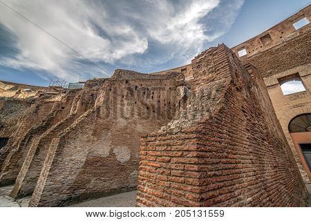 ROME ITALY - MAY 30 2017: View inside the Colosseum Rome Italy with specific ruins and sky with clouds in background.