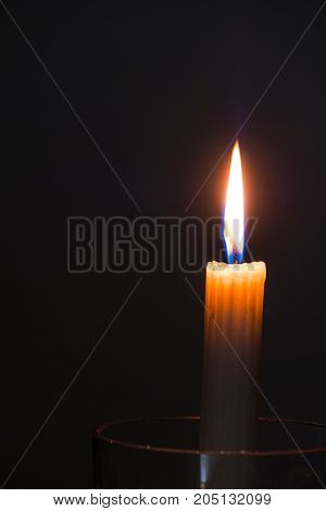 Single Candle On A Black Candle