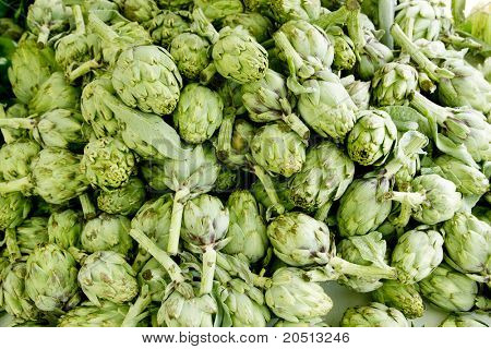 artichokes vegetables in a market stacked mound healthy food