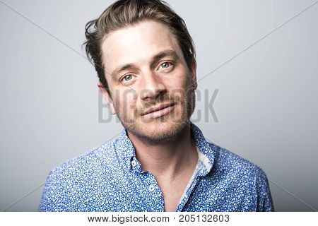 A Portrait of european man isolated over white background. Caucasian male model in studio shoot.