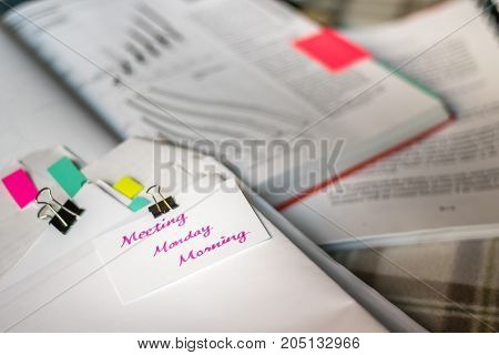 Meeting Monday Morning; Stack Of Documents With Large Amount Of Analytic Material.