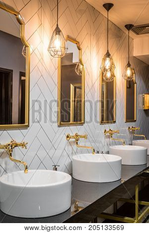 Mirrors and sinks in public toilet in restaurant or hotel